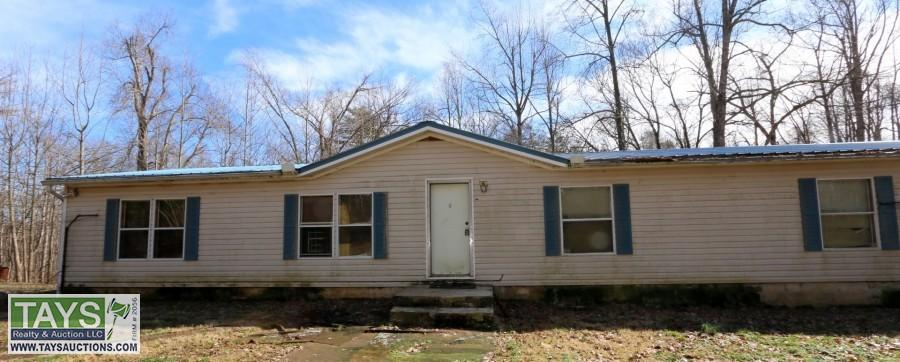 ONLINE BANKRUPTCY AUCTION: 5 BR / 3 BA MANUFACTURED HOME ON 6.35 AC± - OUTBUILDINGS - SEMI TRAILER