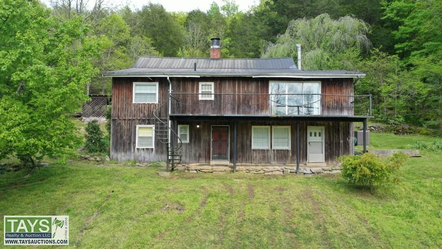 ONLINE CHANCERY COURT AUCTION: CANEY FORK RIVER HOME ON 71.66 AC±