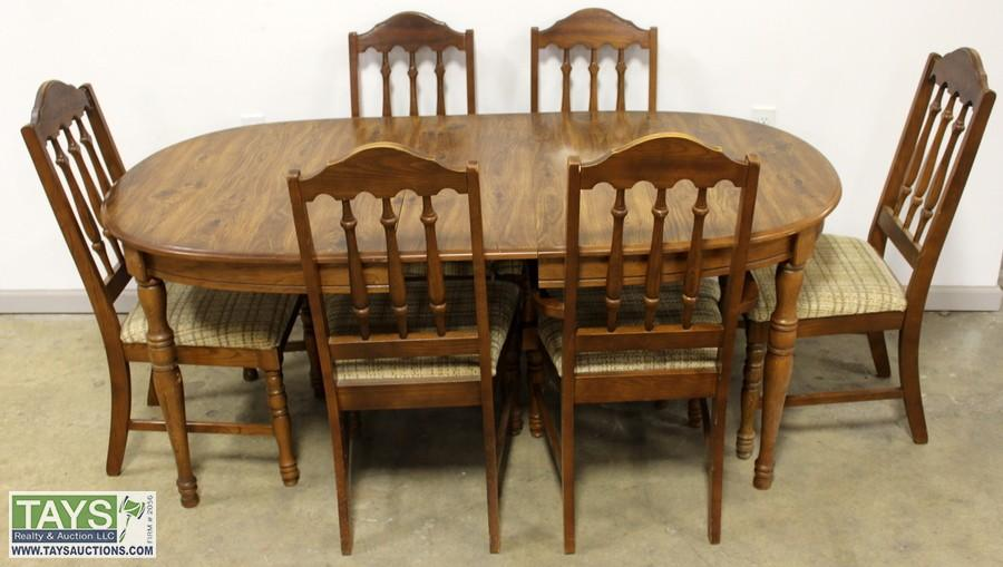 dining table and six bassett furniture chairs