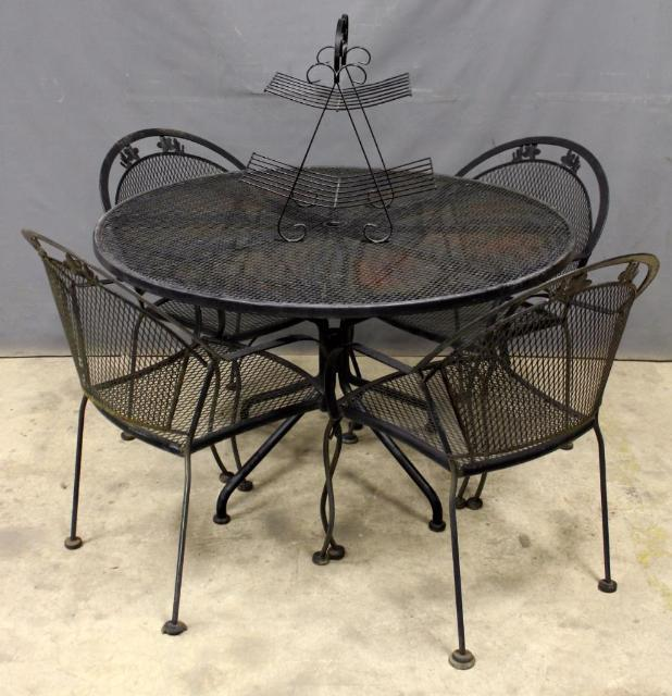 Wrought Iron Patio Dining Set And A Fruit Stand Centerpiece
